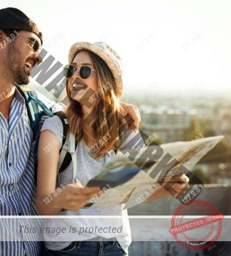 Young couple traveling with a map in the city